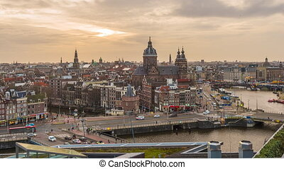 Amsterdam, Netherlands town cityscape over the Old Centre District with Basilica of Saint Nicholas.