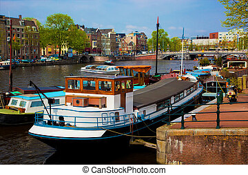 Amsterdam old town canal, boats.
