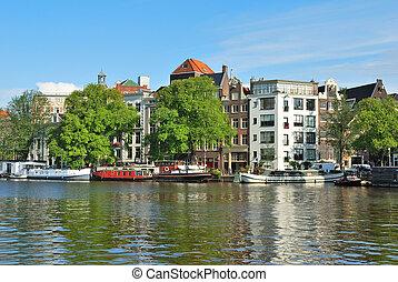 Amsterdam. River Amstel embankment - Amsterdam. Beautiful ...