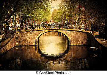Amsterdam. Romantic bridge over canal.