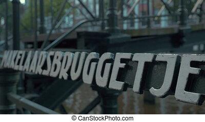 Amsterdam slogan and Makelaarsbruggetje footbridge -...