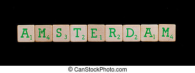 Amsterdam spelled out in old wooden blocks