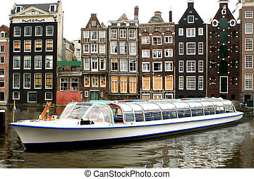 Amsterdam tourism - Amsterdam canal with with sightseeing...