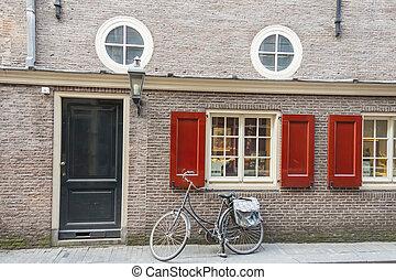Amsterdam typical view, bike and birck wall - Netherlands, Europe.