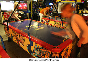 Amusement Arcade - Girls playing in an amusement arcade at...