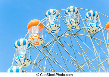 Amusement ferris wheel in the park