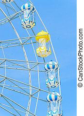 Amusement ferris wheel in the park