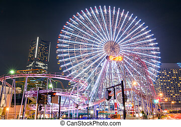 Amusement park and skyscraper - Light up of amusement park ...