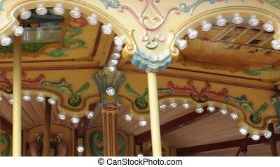Amusement park details. Glowing lights and various ornaments.