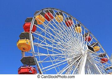 Amusement park - Ferris wheel in amusement park in Santa...