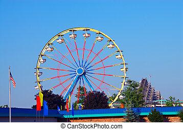 Amusement Park - Ferris wheel ride at an amusement park in ...