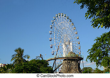 ferris whee - amusement park huge ferris wheel against blue...