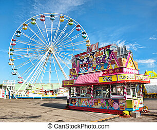 ferris wheel and candy stand on a midway at a fair