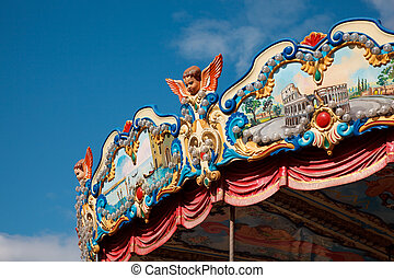 Amusement park - piece of roof of carousel, richly decorated...