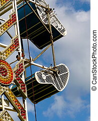 Abstract detail of carnival ride with brightly colored neon lights