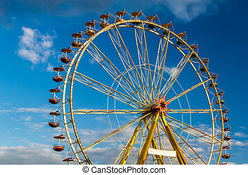 Amusement park with blue sky and clouds