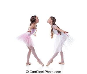 Amusing ballerinas posing looking at each other - Amusing...