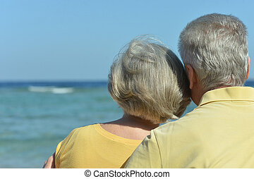 Amusing elderly couple on a beach - Amusing elderly couple...