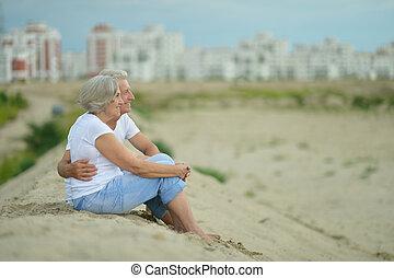 Amusing elderly couple - Amusing happy elderly couple on the...