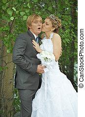 Amusing groom and bride kiss secretly - Amusing groom and...