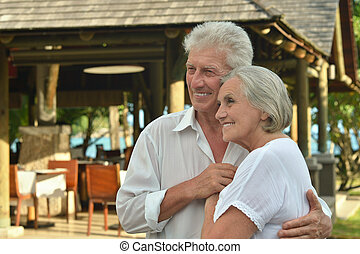 Amusing old couple at cafe
