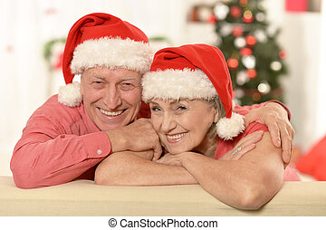 Amusing old couple at Christmas - Amusing old couple wearing...