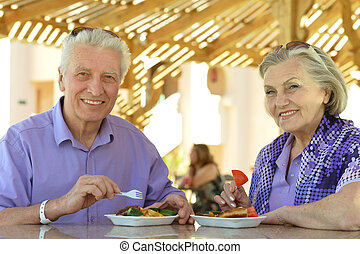 Amusing old couple - Portrait of amusing old couple in cafe