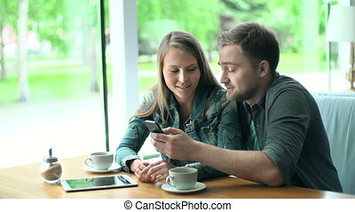 Amusing Pastime - Close up of young couple having fun with...