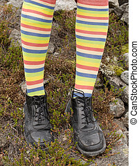 Amusing striped feet in boots