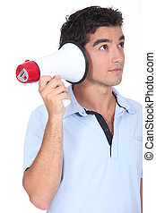 Amusing studio shot of man with a megaphone