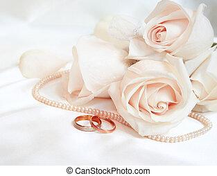 anéis casamento, e, rosas