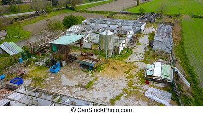 Abandoned and roofless animal husbandry buildings
