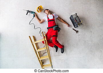 An accident of a man worker at the construction site. Top view.