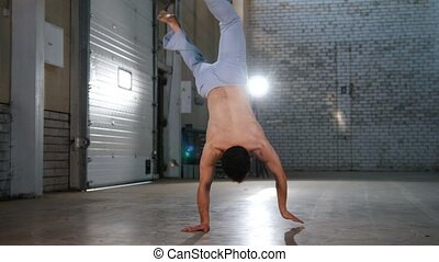 An acrobatic man training his skills. Performing capoeira...