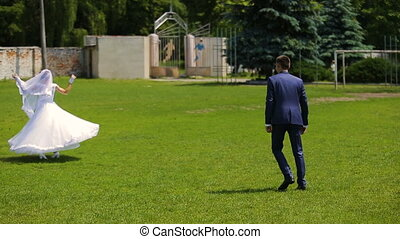 An adorable couple plays soccer in the front yard