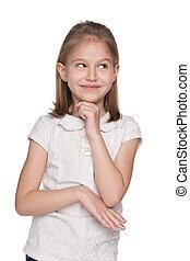 An adorable little girl imagines