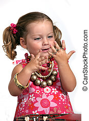 An adorable little girl with plenty of jewelry.