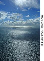 An aerial photograph from a helicopter over a body of water...