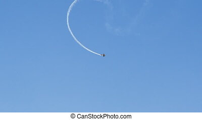 An aerial plane show - A shot of a plane making an aviation...