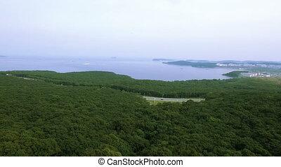 An aerial shot of pacific ocean bay