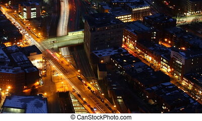 Aerial timelapse of the Boston city center at night with zoom out