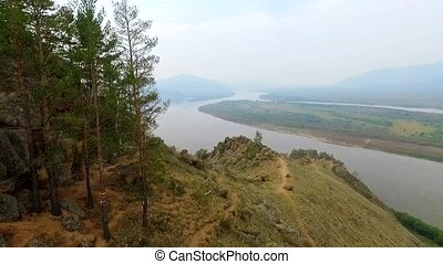 An aerial view flying over the river in the fog, Russian Buryatia