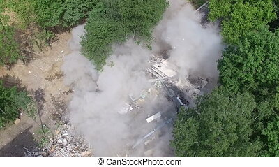 An aerial view of a building being demolished - An aerial ...