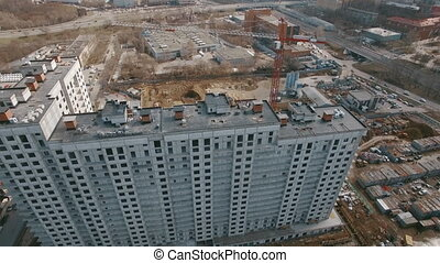 An aerial view of a building construction on a bright day -...