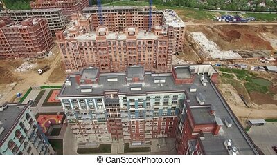 An aerial view of a construction area in a residential buildings complex