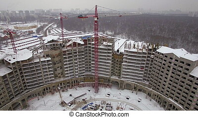 An aerial view of a huge winter building construction zone