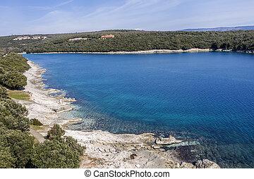 An aerial view of beautiful beach in Duga Uvala, Istria, Croatia