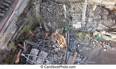 An aerial view of demolished building constructions piled on...