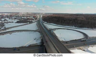 An aerial view on a highway at winter. Large traffic...