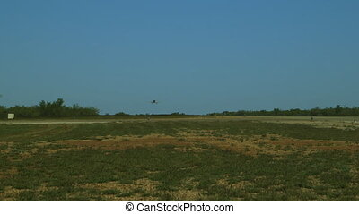 An aeroplane landing on a long runway
